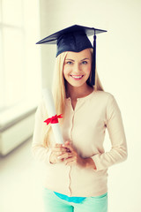 student in graduation cap with certificate