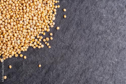 Staande foto Kruiderij Mustard seeds on dark background
