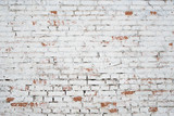 Fototapety Cracked white grunge brick wall textured background stained old