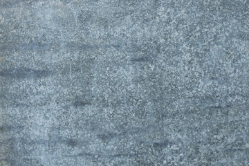The vintage gray rusty grunge iron metallic textured background