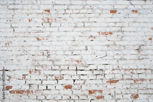 Cracked white grunge brick wall textured background stained old - 67378668