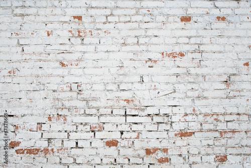 Leinwandbild Motiv Cracked white grunge brick wall textured background stained old