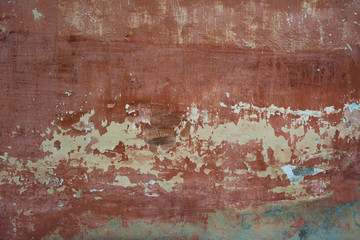 Rough textured background red old cement wall with stains, dry