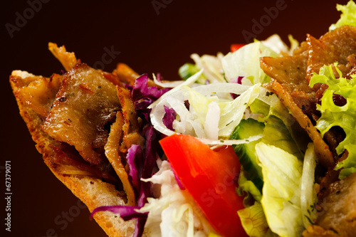 Kebab - grilled meat, bread and vegetables - 67379071