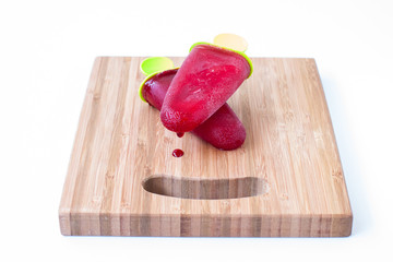 ice lolly on a wooden board