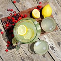 Fresh Lemonade and Fruit Framing Rustic Wood Background