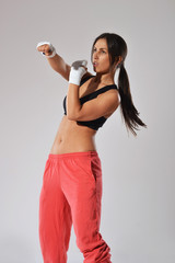 fitness woman with white bandages, studio shot