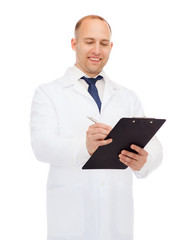 smiling male doctor with clipboard and pen