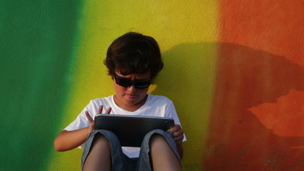Boy using digital tablet