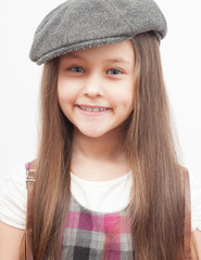 portrait of a cute little girl in a cap