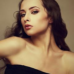 Gloss closeup portrait of beautiful sexy bright makeup woman