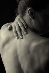 Body scape of woman back in low light emotion artistic conversio
