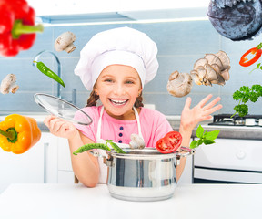 little girl preparing vegetarian soup
