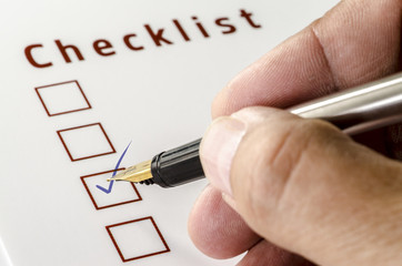 Person Marking in a Checkbox on white paper
