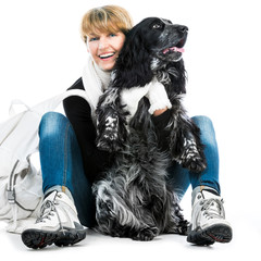 young modern woman with her dog cocker spaniel