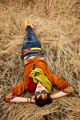 man lying on the dry grass