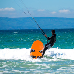 Kite surfing on a pristine beach