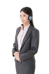 Attractive young business woman with a headphone