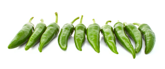 Green hot pepper in a row