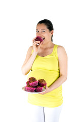 Pregnant woman eating muffins