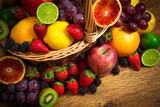 Mix of fresh fruits on wicker bascket poster