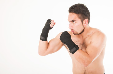 muscular martial arts fighter attacking