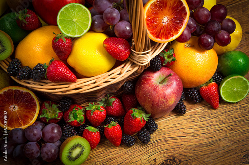 Fotobehang Vruchten Mix of fresh fruits on wicker bascket