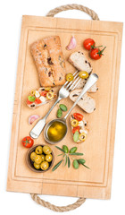 bread with tomato, garlic and olives on the wooden board