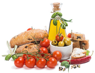 Olive oil with green olives, tomatoes and bread