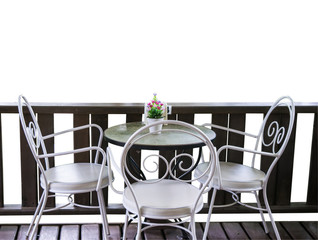 White table and chairs in garden.