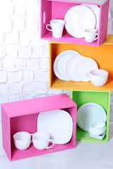 Beautiful  bright shelves and boxes with tableware