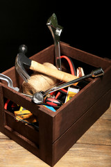 Wooden box with different tools,