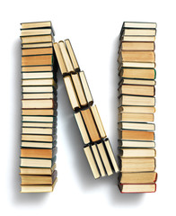 Letter N formed from the page ends of books