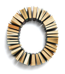 Letter O formed from the page ends of books