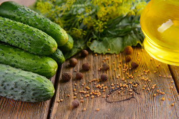 Fresh cucumbers and spices on wooden table, close-up