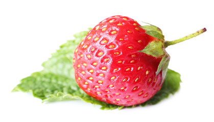 Ripe strawberry with mint leaf isolated on white