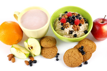 Healthy oatmeal in bowl with berries and fruits, close up