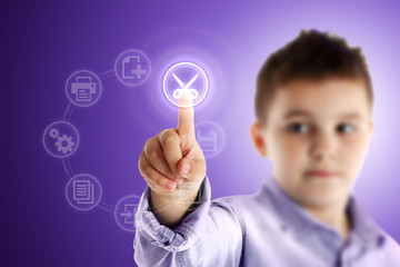 Cut. Boy pressing a virtual touch screen. Purple background.