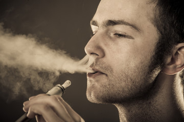 Man smokes electronic cigarette