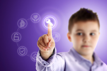 Key. Boy pressing a virtual touch screen. Purple background.