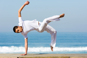 young woman practicing capoeira