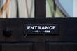 Entrance sign on a black door