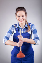 Handywoman with a plunger