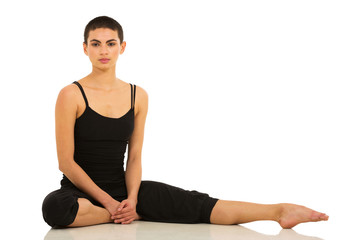 young female dancer sitting in studio