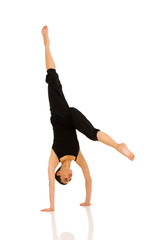 female dancer practicing handstand