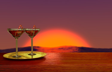 two glasses on golden plate with romantic sunset on background