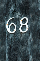 Number 68 on a timber post for use as a background