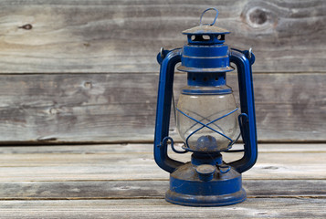 Old dirty Lantern on aged wood