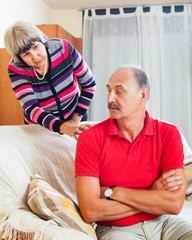 Mature  couple after quarrel in living room