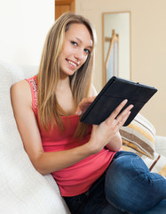 Girl on sofa with tablet pc